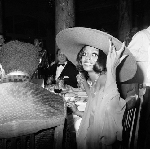 1973, Cannes, France --- American soul, pop, and rhythm and blues singer Diana Ross wears a large hat at dinner during the Cannes Film Festival. --- Image by © Mirkine/Sygma/Corbis